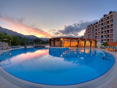 Naturist camping Bunculuka hotel Corinthia Baška pool by night  | AdriaCamps